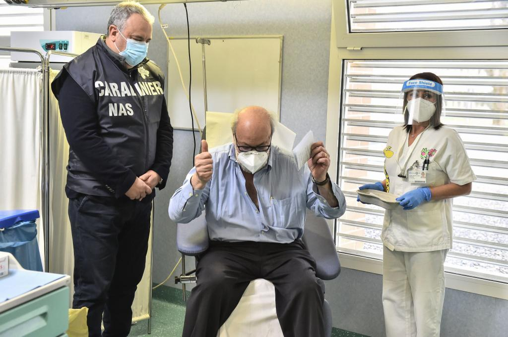 Codogno (Italy), 08/09/2014.- Massimo Vajani reacts next to an Italian Carabinieri officer after he received the Pfizer-BioNTech COVID-19 vaccine at Civico hospital, where the country's first patient was diagnosed, in Codogno, Italy, 27 December 2020. A vaccination campaign against Covid-19 started across the EU on 27 December. (Italia) EFE/EPA/FLAVIO LO SCALZO / POOL