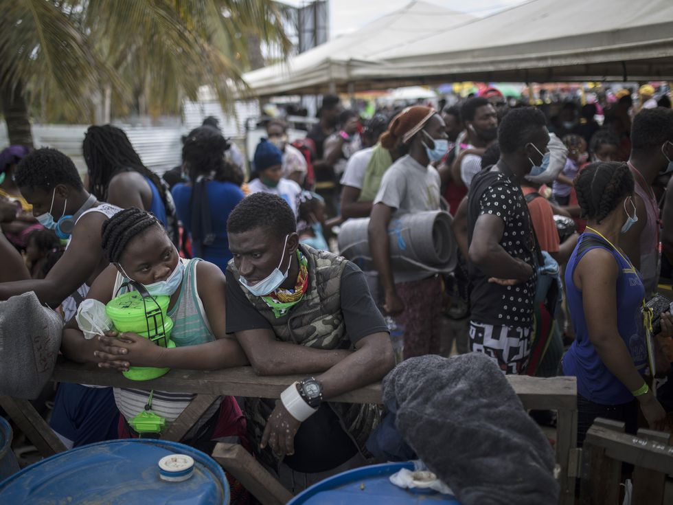 Haitianos refugiados, esperan para salir en lancha hacia Capurgana, in Necocli, Colombia, Wednesday, July 28, 2021. (AP Photo/Ivan Valencia)